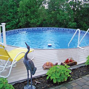 Ispirazione per una piscina fuori terra classica personalizzata di medie dimensioni e dietro casa con pedane