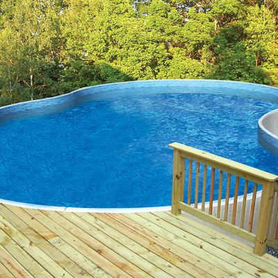 Large elegant backyard custom-shaped aboveground pool photo in Other with decking