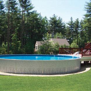 Aménagement d'une piscine hors-sol et arrière contemporaine de taille moyenne et ronde avec du gravier.