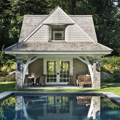 Pool house - traditional backyard rectangular pool house idea in New York
