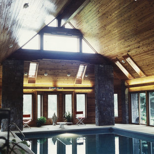 Expansive scandinavian rectangular pool in Minneapolis with a hot tub and tile.