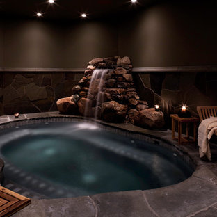 Mountain style indoor pool photo in Burlington