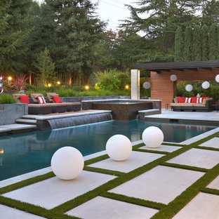 Inspiration for an expansive contemporary back l-shaped swimming pool in San Francisco with concrete paving and a hot tub.