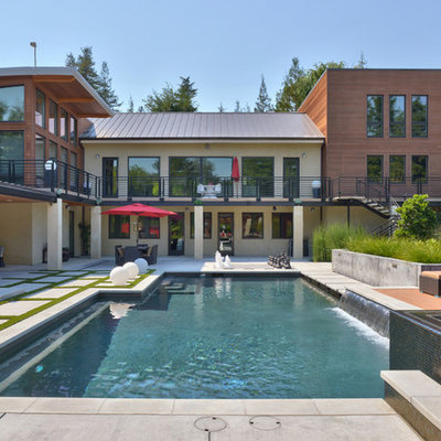 Example of a huge trendy backyard custom-shaped and concrete paver hot tub design in San Francisco