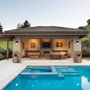 Inspiration for a large classic back rectangular swimming pool in San Francisco with a pool house.