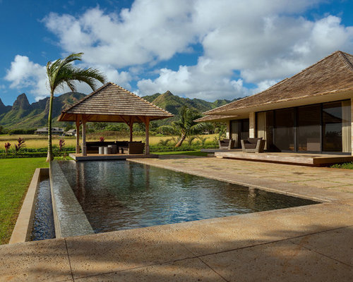 Charmant Pool   Tropical Backyard Concrete Paver And Rectangular Infinity Pool Idea  In Hawaii