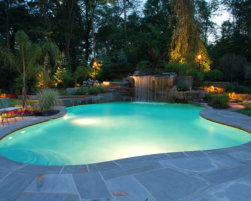 Example Of An Island Style Custom Shaped Pool Design In New York