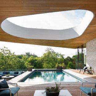 Minimalist rectangular pool photo in Austin with decking