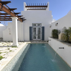 Mediterranean Pool by Troy Rhone Garden Design