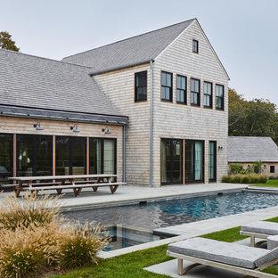 Ejemplo de piscinas y jacuzzis marineros, rectangulares, con suelo de baldosas