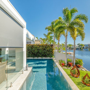Photo of a mid-sized modern backyard l-shaped pool in Sunshine Coast.