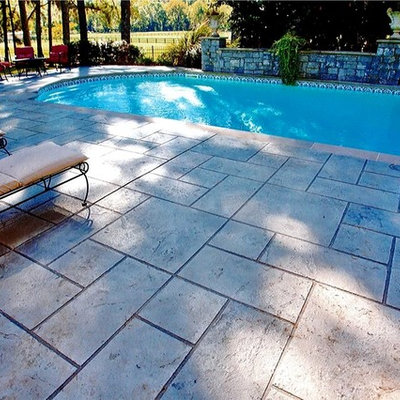 Pool - mid-sized mediterranean courtyard custom-shaped aboveground pool idea in Other with decking