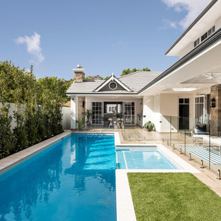 Inspiration for a traditional backyard rectangular lap pool in Perth with decking.