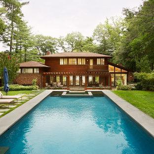 Diseño de piscinas y jacuzzis alargados, de estilo americano, extra grandes, rectangulares, en patio trasero