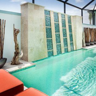 Idées déco pour un couloir de nage arrière asiatique de taille moyenne et rectangle avec un point d'eau et des pavés en pierre naturelle.