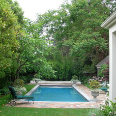 Traditional Pool by Zeterre Landscape Architecture