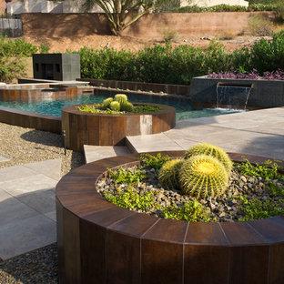 Mediterranes Pool mit Kies in individueller Form in Phoenix