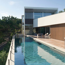 Modern Pool by Foursquare Builders