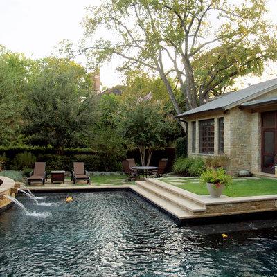 Example of a classic backyard custom-shaped pool design in Austin