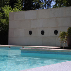 Traditional Pool by Archiverde Landscape Architecture