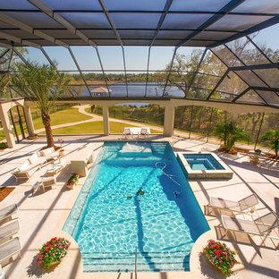 Foto de piscinas y jacuzzis tradicionales renovados, grandes, interiores y rectangulares, con suelo de baldosas