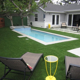 Design ideas for a small contemporary backyard rectangular natural pool in Los Angeles with a hot tub and concrete pavers.