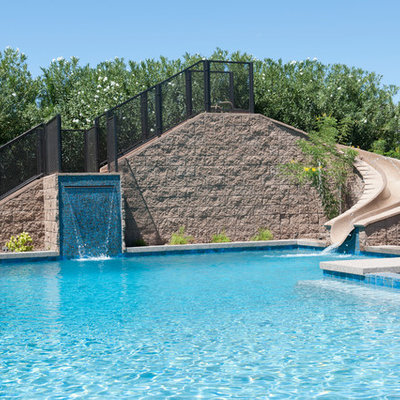 Inspiration for a mid-sized contemporary backyard concrete paver and rectangular water slide remodel in Phoenix