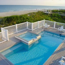 Beach Style Pool by Bluewater Pools and Spa