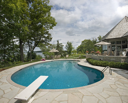 Example Of A Classic Kidney Shaped Pool Design In Minneapolis
