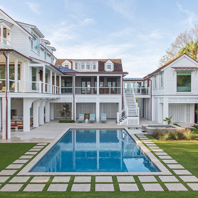 Inspiration for a large coastal backyard stone and rectangular pool remodel in Charleston