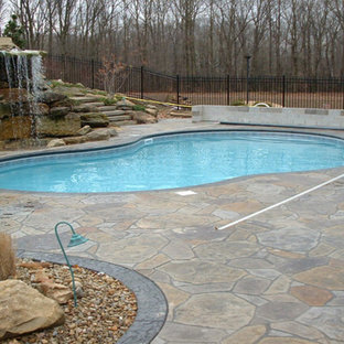 Inspiration for a mid-sized rustic backyard stone and custom-shaped water slide remodel in Other