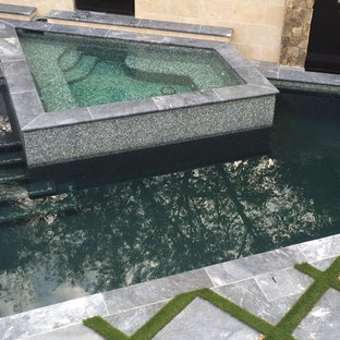 Mid-sized trendy backyard custom-shaped and stamped concrete hot tub photo in Raleigh