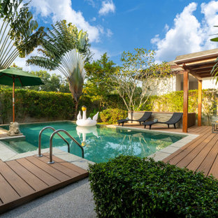 Inspiration for a contemporary rectangular pool remodel in Miami with decking