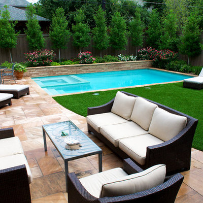 Inspiration for a small transitional backyard stone and rectangular hot tub remodel in Dallas