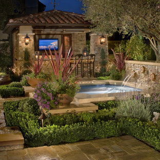 Inspiration for a small country backyard custom-shaped pool in Los Angeles with a hot tub and natural stone pavers.