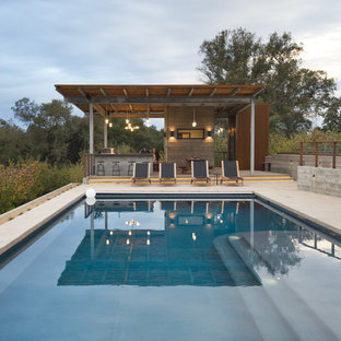 Design ideas for a large modern backyard rectangular lap pool in San Francisco with a pool house.