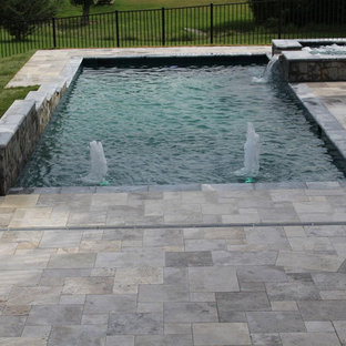 Inspiration for a small rustic backyard stone and rectangular natural hot tub remodel in DC Metro