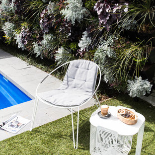 Photo of a scandinavian rectangular natural pool in Melbourne with tile.