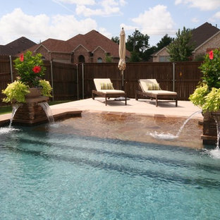 Example of a beach style pool design in Dallas