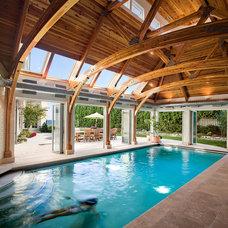 Beach Style Pool by Nelson Edwards Company Architects, LLC