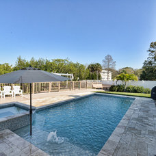 Traditional Pool by Javic Homes