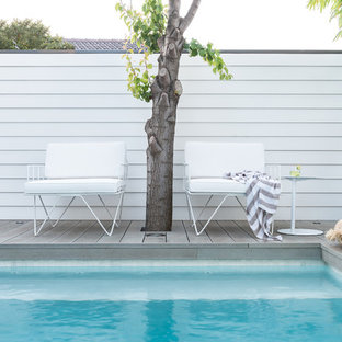 Design ideas for a small beach style backyard pool in Perth with decking.