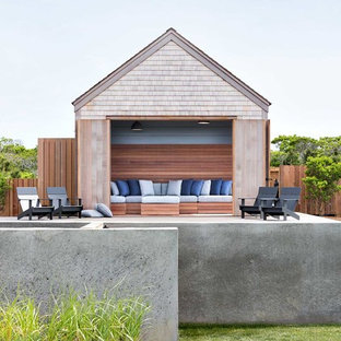 Example of a beach style pool design in New York