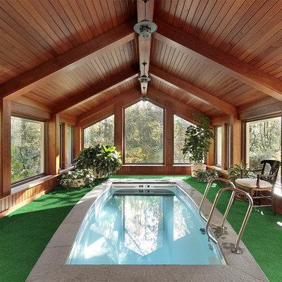 Minimalist backyard pool photo in Other