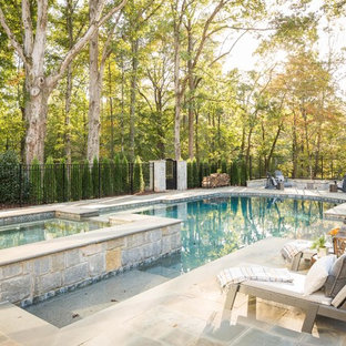 Example of a large country backyard stone and l-shaped hot tub design in Atlanta