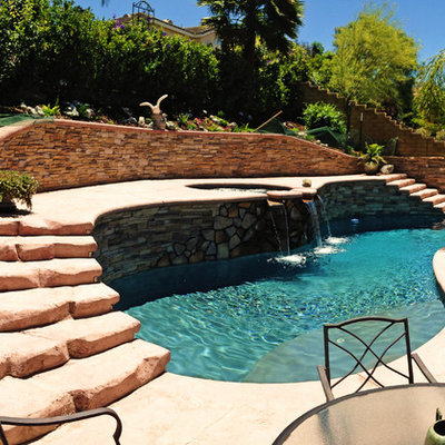Inspiration for a mid-sized mediterranean backyard stamped concrete and custom-shaped aboveground pool remodel in Los Angeles