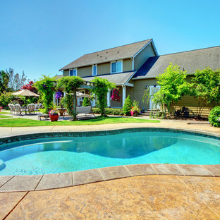 Photo of a mid-sized traditional backyard kidney-shaped pool in San Francisco with concrete pavers.