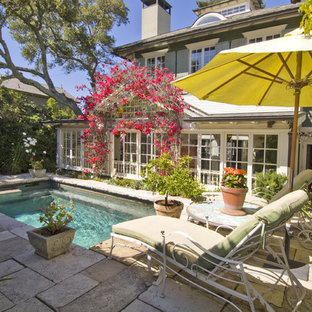 Example of a small classic backyard stone and rectangular pool design in San Francisco