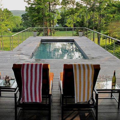 Pool - contemporary pool idea in Boston with decking