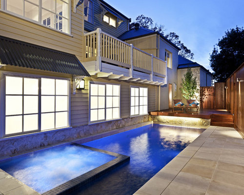 Example Of A Trendy Concrete Paver Pool Design In Melbourne